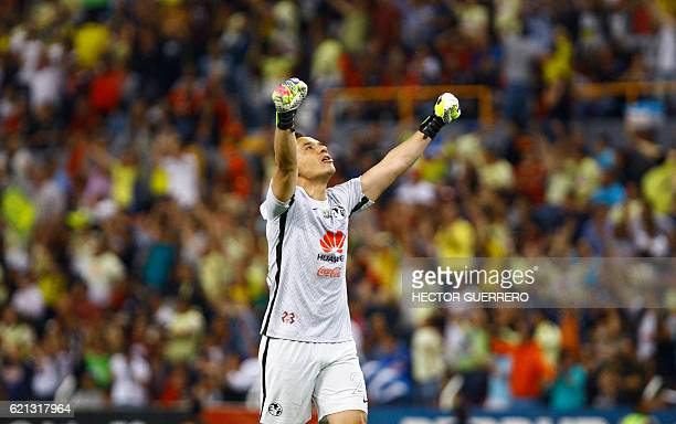 America goalkeeper Moises Munoz celebrates after scoring in their Mexican Apertura 2016 tournament football match against Atlas at Jalisco stadium on...