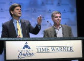 America Online Chairman Steve Case and Time Warner Chairman Gerald Levin announce their companies' merger 10 January 2000 at a New York news...