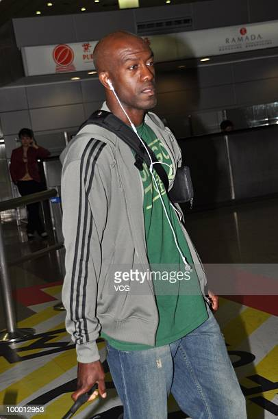 American 110meter hurdler Allen Johnson arrives at Shanghai Pudong airport for the IAAF Diamond League Shanghai on May 20 2010 in Shanghai China