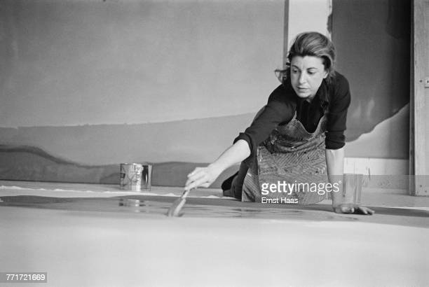American abstract expressionist painter Helen Frankenthaler at work on a large canvas 1969
