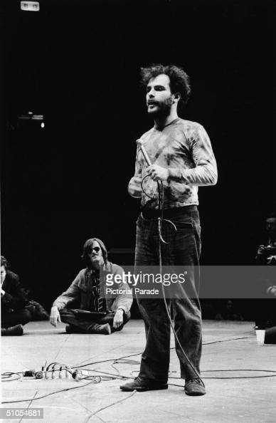 American activist and author Jerry Rubin speaks at the Senators for Peace rally in Madison Square Garden while actor Peter Fonda sits on the stage...