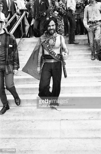 American activist Jerry Rubin smiles as he walks down the steps barefoot outside the 1968 Democratic National Convention Chicago Illinois August 1968...