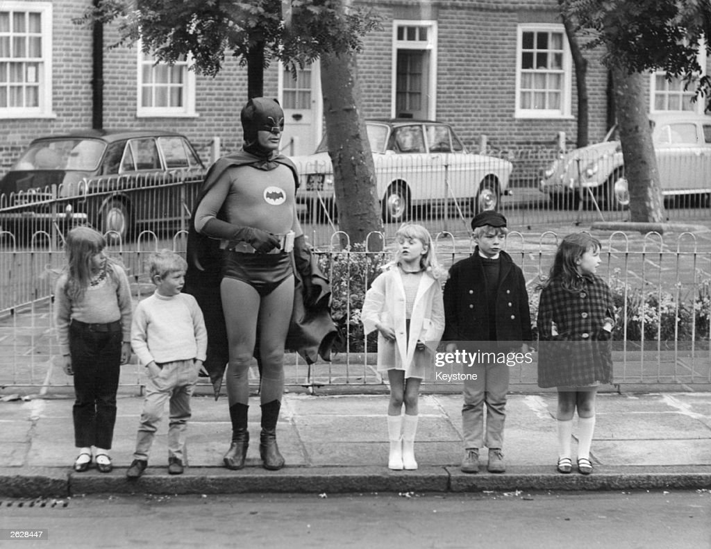 American actor Adam West, as Batman, making a road safety film with a group of child actors in Kensington, London. Original Publication: People Disc - HM0458