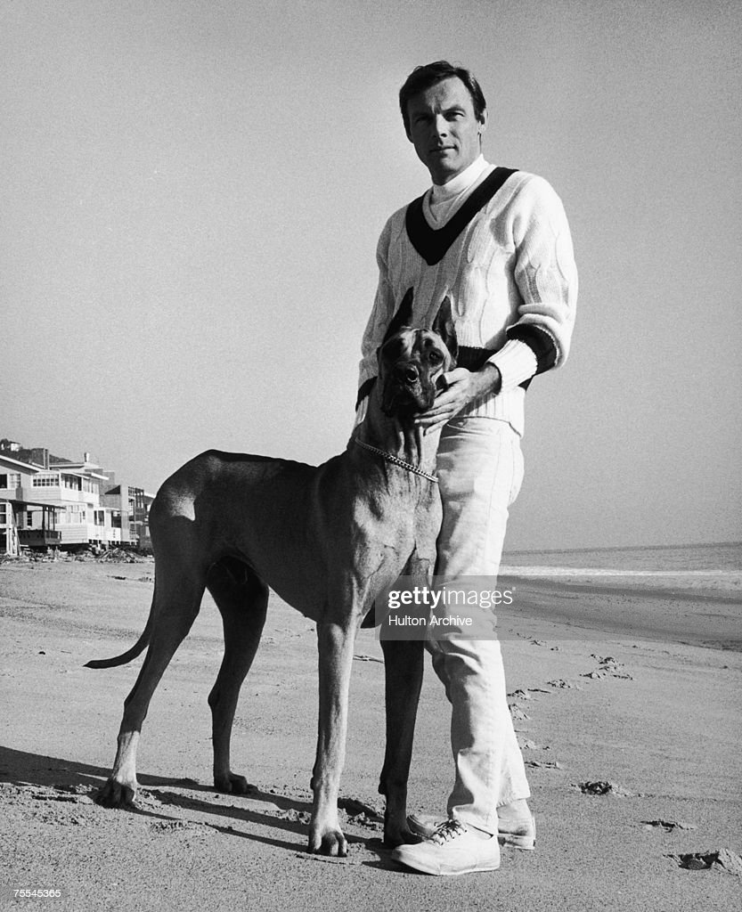 American actor Adam West, best known for his TV role as Batman, with a great dane he calls 'Batdog', circa 1967.