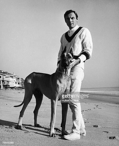 American actor Adam West best known for his TV role as Batman with a great dane he calls 'Batdog' circa 1967