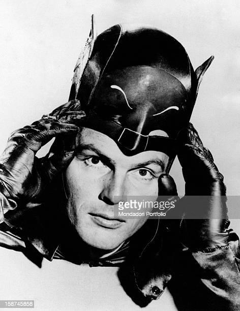 American actor Adam West putting on the mask of the comics superhero Batman in the TV serie Batman 1966