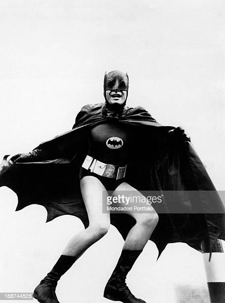 American actor Adam West wearing the costume of the comics superhero Batman and acting in the TV serie Batman 1966