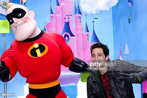 American actor Adrien Brody and an actor dressed as Mr Incredible pose on the red carpet during the New Generation Year Launch at Disneyland Paris on...