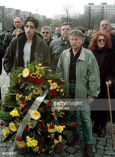 American actor Adrien Brody Polish film producer Lew Rywin and PolishFrench film director Roman Polanski lay flowers at the Monument to the Ghetto...