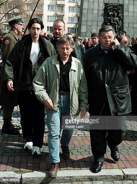 American actor Adrien Brody PolishFrench film director Roman Polanski and Polish film producer Lew Rywin lay flowers at the Monument to the Ghetto...