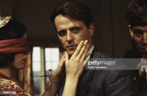 American actor Aidan Quinn and English actress Kate Beckinsale play Blind Man's Buff with Anthony Andrews in a scene from the film 'Haunted' 1995