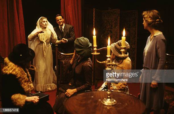 American actor Aidan Quinn debunks a seance in a scene from the film 'Haunted' 1995