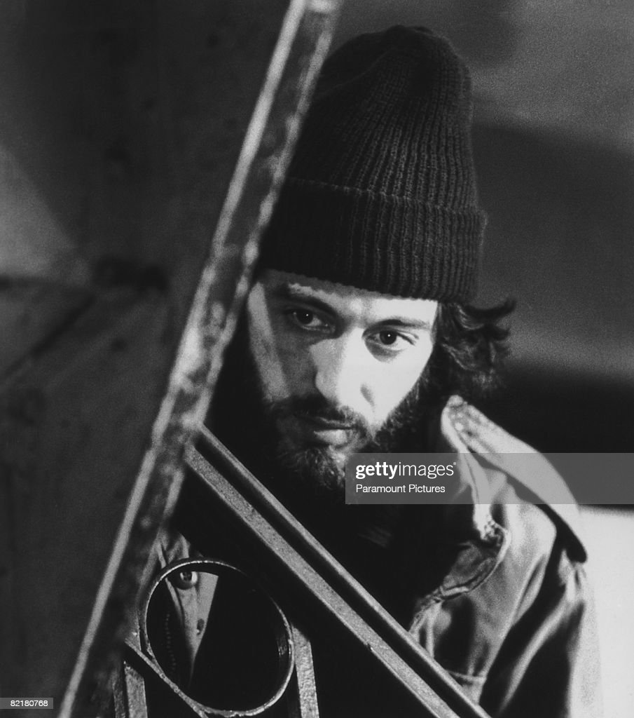 American actor Al Pacino, as officer Frank Serpico, waits in a hallway before apprehending drug dealers in a scene from Sidney Lumet's police corruption drama 'Serpico', 1973.