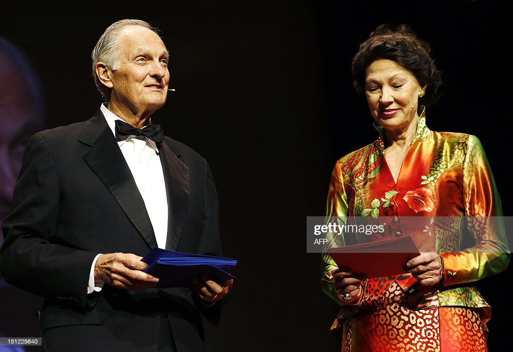 American actor Alan Alda (L) and former Norwegian Minister of Culture Aase Kleveland speak on stage as masters of ceremony during the announcement of the prestigious 2012 Kavli prizes for neuroscience, astrophysics, and nanoscience, in Oslo, on September 4, 2012.