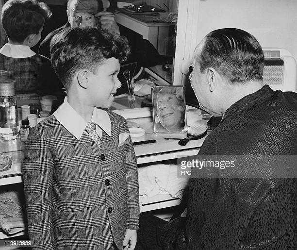 American actor and comedian Bert Lahr in his dressing room backstage at the Belaco Theater with his son John circa 1947 Lahr senior is appearing in...