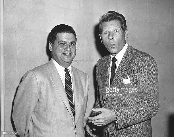 American actor and comedian Danny Kaye makes a surprised face as he poses with an unidentified White house staffer August 26 1956