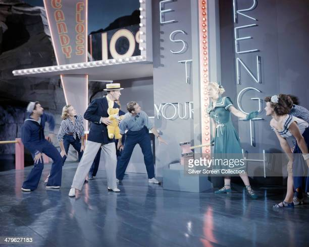 American actor and dancer Fred Astaire and actress Betty Hutton in a fairground scene from 'Let's Dance' directed by Norman Z McLeod 1950