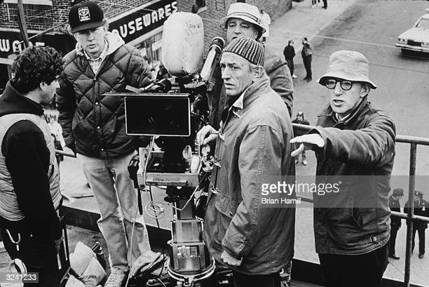 American actor and director Woody Allen talks to Italian cinematographer Carlo Di Palma and other film crew members during the shooting of Allen's...