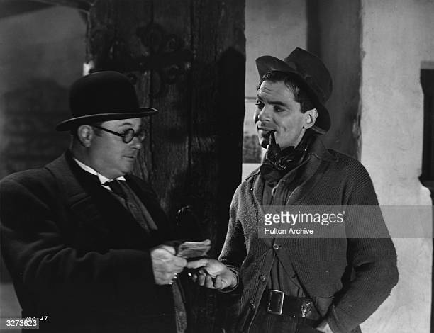 American actor and later politician John Lodge plays the title role in the film 'Bulldog Drummond at Bay' directed by Norman Lee for Wardour Films He...
