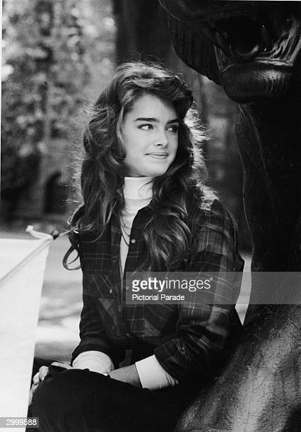 American actor and model Brooke Shields sits by a statue during a tour of the Princeton University campus before becoming a student September 1981