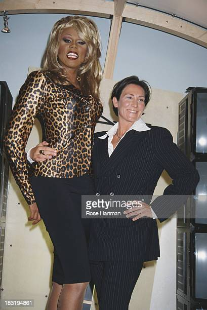 American actor and recording artist RuPaul and Canadian pop and country singersongwriter KD Lang attend a MAC Cosmetics party 1996