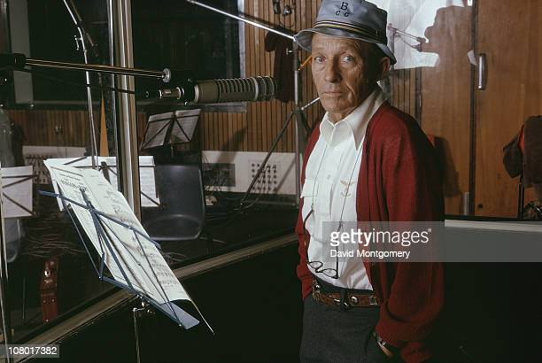 American actor and singer Bing Crosby in a recording studio circa 1975 On the stand in front of him is a piece of sheet music by Rodgers and...