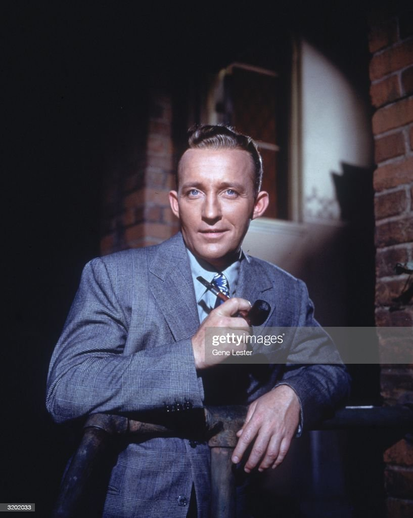 American actor and singer <a gi-track='captionPersonalityLinkClicked' href=/galleries/search?phrase=Bing+Crosby&family=editorial&specificpeople=90412 ng-click='$event.stopPropagation()'>Bing Crosby</a> poses for a portrait holding a pipe in his hand.