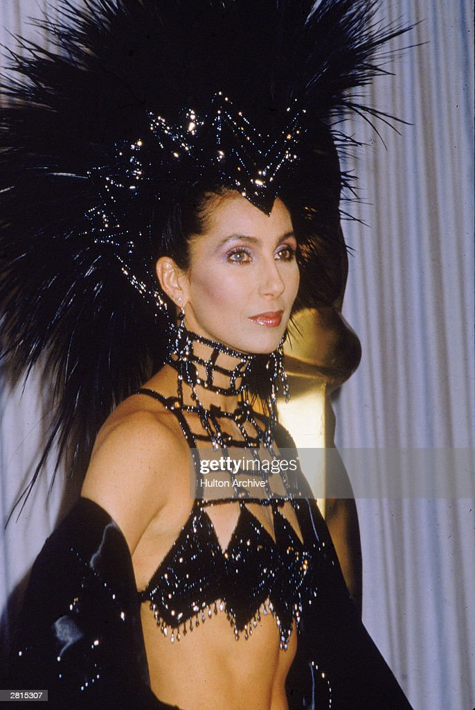 American actor and singer Cher attends the Academy Awards ceremony wearing a black headdress at the Dorothy Chandler Pavilion of the LA Music Center...