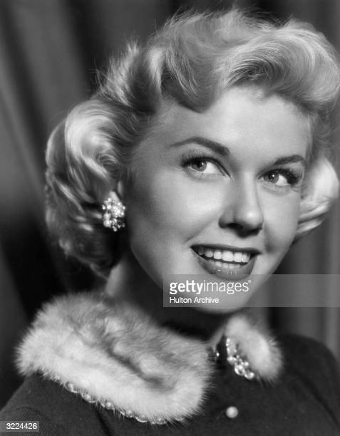 American actor and singer Doris Day wearing a jacket trimmed with a fur collar in a promotional headshot portrait for director David Butler's film...