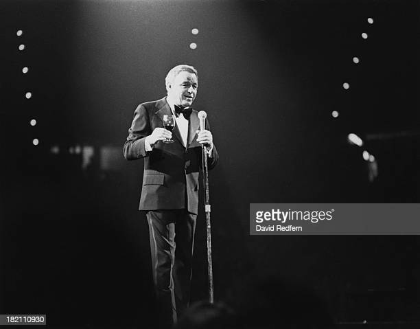 American actor and singer Frank Sinatra holding a glass of wine during a performance circa 1975
