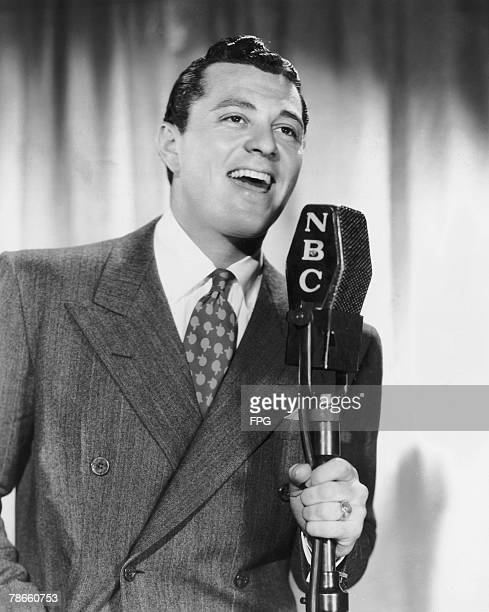 American actor and singer Tony Martin singing on NBC Radio's George Burns and Gracie Allen programme 7th July 1937