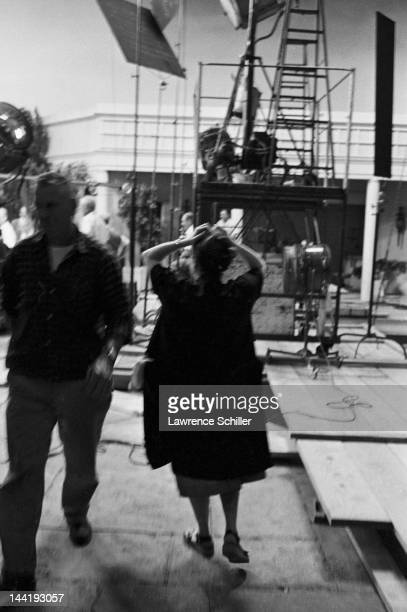 APPLY American actor and teacher Paula Strasberg stands with her hands on her head as she watches a scene on set during the filming of 'Something's...
