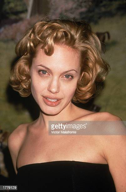 American actor Angelina Jolie attends an event wearijg a strapless black gown New York City circa 1998