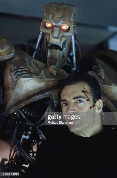 American actor Armand Assante as the psychotic Rico with his combat robot in the dystopian scifi film 'Judge Dredd' 1995