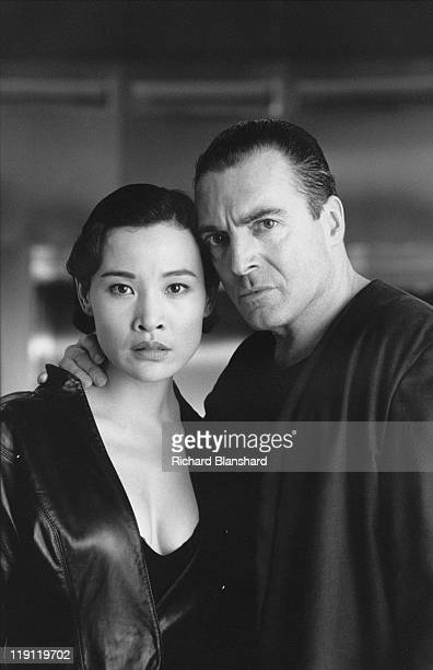 American actor Armand Assante stars with Chinese actress Joan Chen in the dystopian scifi film 'Judge Dredd' 1995