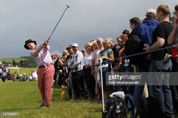 American Actor Bill Murray hits his second shot on the 17th hole during the Pro Am for the 2012 Irish Open held on the Dunluce Links at Royal...