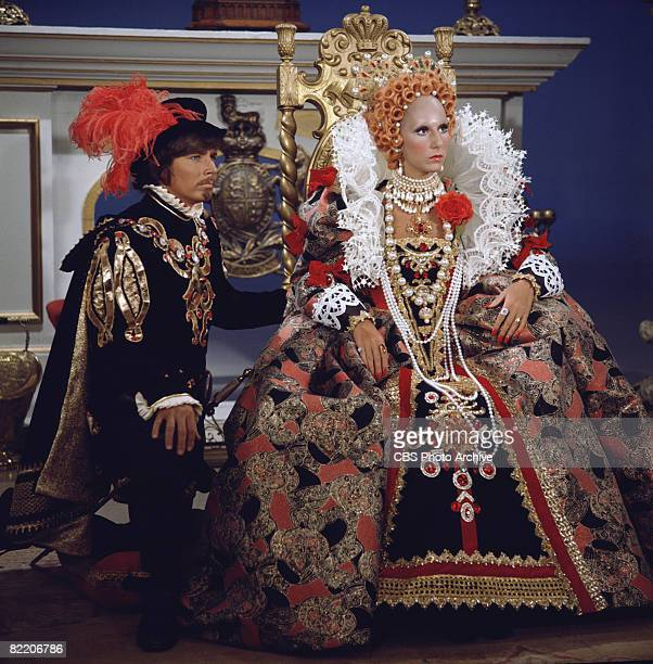 American actor Bobby Sherman kneels beside American singer and actress Cher as she sits on a throne dressed in royal finery in a skit on the...