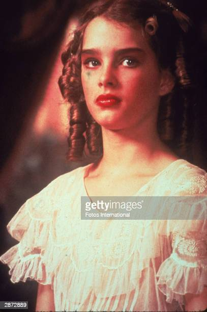 American actor Brooke Shields wears a ruffled blouse and heavy makeup in a still from the film 'Pretty Baby' directed by Louis Malle 1978