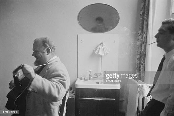 American actor Burl Ives and Hungarian war photographer and photojournalist Robert Capa during a visit to American film director John Huston in...