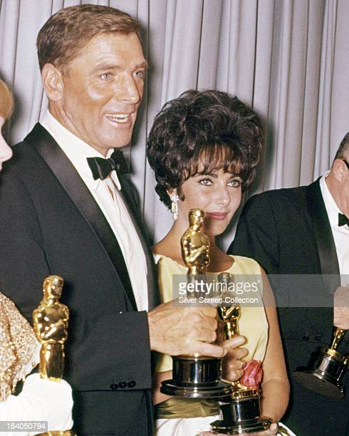American actor Burt Lancaster and Britishborn American actress Elizabeth Taylor at the 33rd Academy Awards Santa Monica California 17th April 1961...