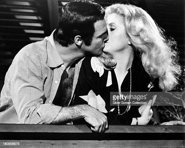 American actor Burt Reynolds as Lieutenant Phil Gaines and French actress Catherine Deneuve as Nicole Britton in 'Hustle' directed by Robert Aldrich...