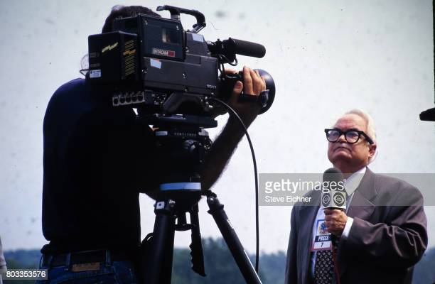 American actor Calvert DeForest in costume as charcter Larry 'Bud' Melman holds a CBS News microphone as he is filmed during the Woodstock '94...