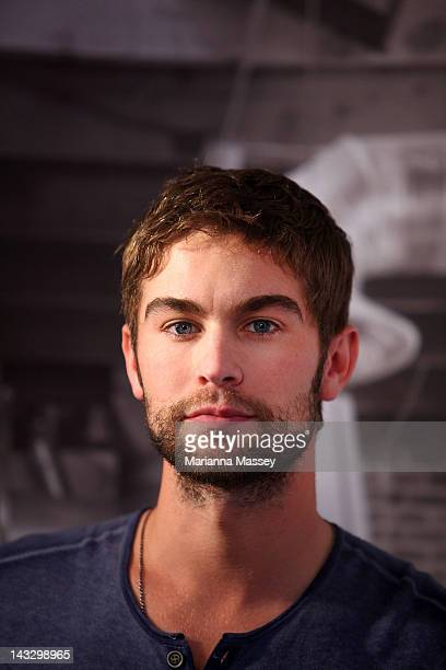 American actor Chace Crawford poses for photos wiht fans at the Diet Coke popup photo set in Martin Place on April 23 2012 in Sydney Australia