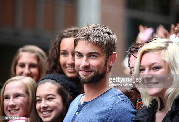 American actor Chace Crawford poses for photos with fans at the Diet Coke popup photo set in Martin Place on April 23 2012 in Sydney Australia