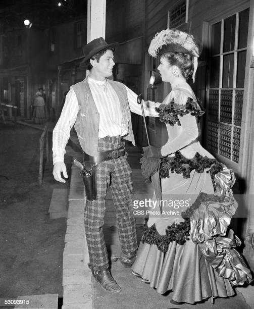 American actor Charles Bronson and American actress Amanda Blake in the episode of the TV western 'Gunsmoke' titled 'The Killer' April 3 1956 The...