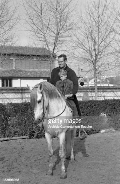 American actor Charlton Heston riding a horse with his son Frazer Lido Venice 1960s