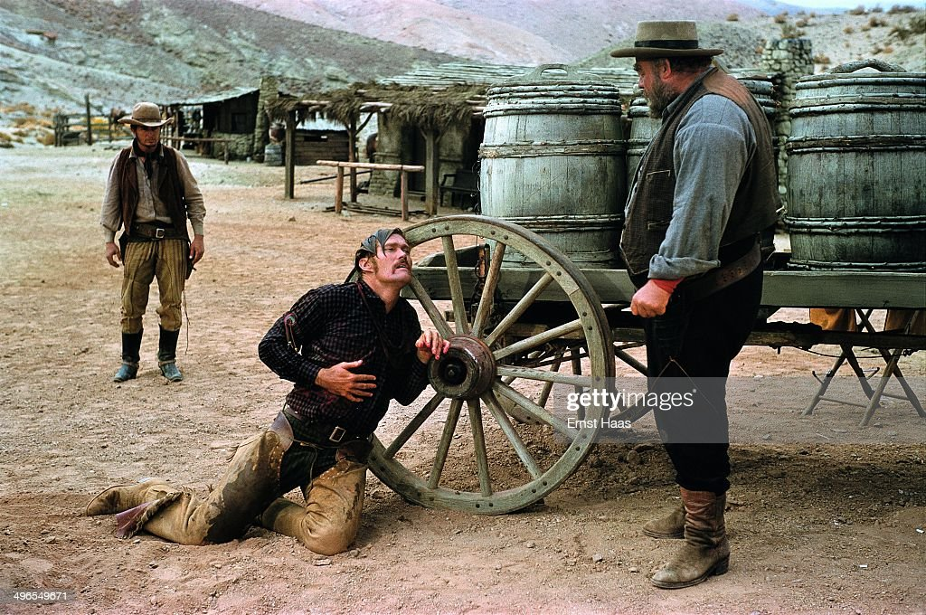American actor <a gi-track='captionPersonalityLinkClicked' href=/galleries/search?phrase=Chuck+Connors&family=editorial&specificpeople=93230 ng-click='$event.stopPropagation()'>Chuck Connors</a> (1921 - 1992) as Buck Hannassey, dying at the hands of his father Rufus Hannassey, played by <a gi-track='captionPersonalityLinkClicked' href=/galleries/search?phrase=Burl+Ives&family=editorial&specificpeople=213222 ng-click='$event.stopPropagation()'>Burl Ives</a> (1909 - 1995), in a scene from the western 'The Big Country', USA, 1958.