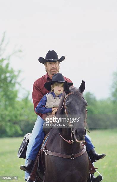 American actor Chuck Norris and Haley Joel Osment ride a horse in a scene from an episode the television series 'Walker Texas Ranger' entitled...
