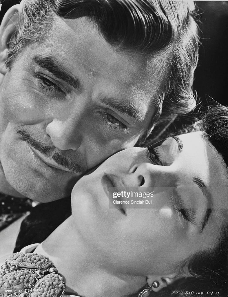 American actor Clark Gable as Rhett Butler and English actress Vivien Leigh as Scarlett O'Hara in a promotional portrait for 'Gone with the Wind '...
