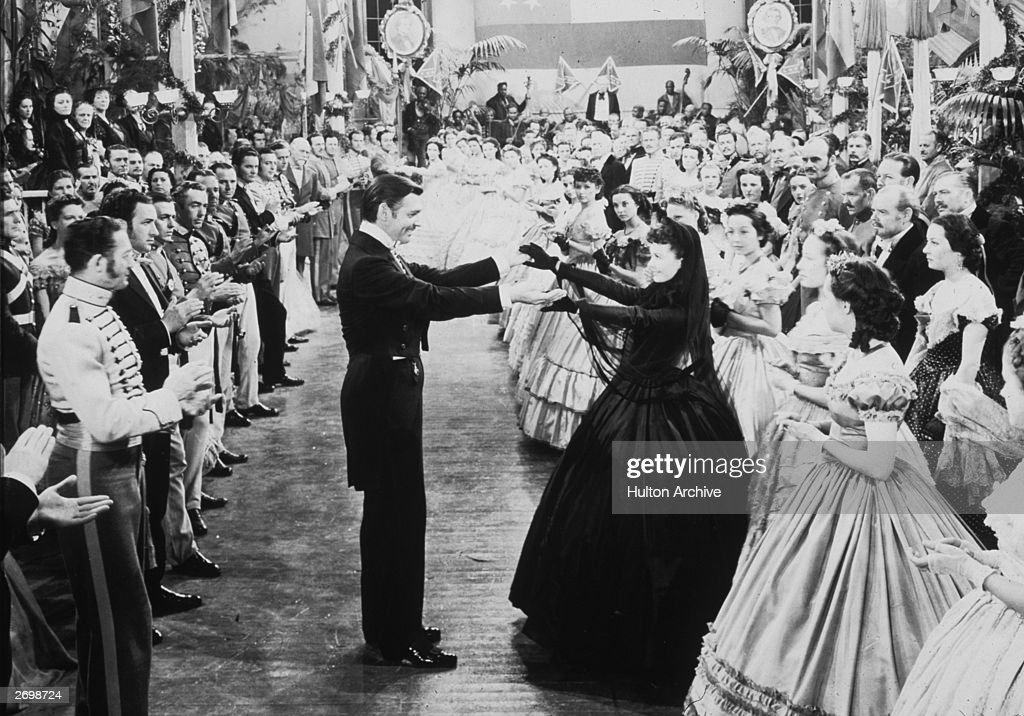 American actor Clark Gable as Rhett Butler and Vivien Leigh as Scarlett O'Hara dancing in a scene from 'Gone With The Wind'